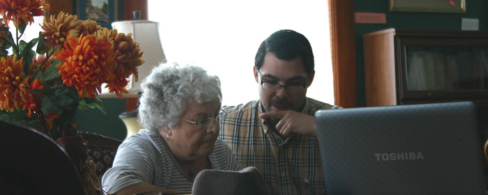 Domenic, one of our Internet Interns, teaches Pat how to use a computer