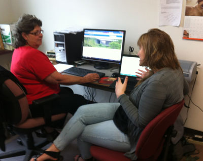 Belinda Clegg and Tess Gauthier learn Wolcott's New Website