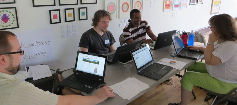 Volunteers work on Digital Economy Free Nonprofit Sites